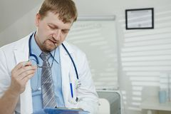 Male doctor working stock image