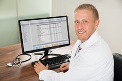Male doctor working on computer Stock Photo