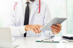 Male doctor working in hospital. Healthcare and medical service stock image