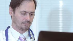 Male doctor working in the office of the laptop, close-up. Male doctor working in the office of the laptop, close-up stock footage