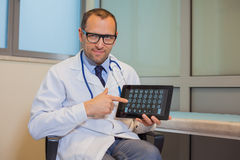 Male doctor working with a tablet computer in his office. Hospit. Al Stock Photo
