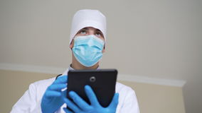 Male doctor working on tablet in hospital in 4K stock video footage
