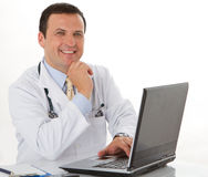 Male doctor write medical reports Stock Image