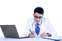Male doctor write medical reports Royalty Free Stock Photography