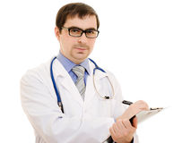 Male doctor writes on the document table Stock Photo