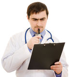 Male doctor writes on the document table Stock Photography