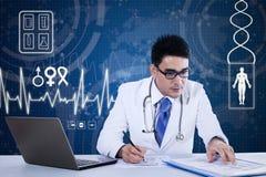 Male doctor writes prescription Royalty Free Stock Photo