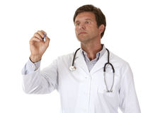 Male doctor writing Royalty Free Stock Photography