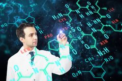 Medicine concept. Male doctor writing chemical formulas on dark background. Medicine concept. Double exposure Stock Photos