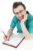 Male doctor writing on clipboard Stock Photography