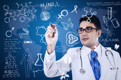 Male doctor is writing on digital screen Stock Photo