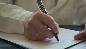 Male doctor writing medical history pan stock footage