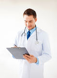 Male doctor writing prescription. Bright picture of male doctor writing prescription Royalty Free Stock Photo