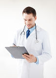 Male doctor writing prescription. Bright picture of male doctor writing prescription Royalty Free Stock Images