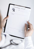 Male doctor writing prescription paper Stock Photography