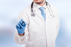Male doctor writing something with marker Royalty Free Stock Images