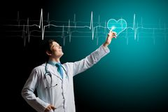 Male doctor. Young male doctor touching digital lightened image stock images
