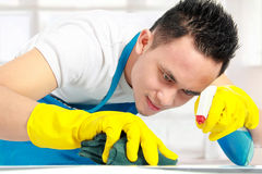Male doing cleaning Royalty Free Stock Photography