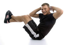 Male doing crunches Stock Photo