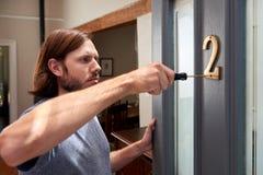 Male doing household duties Stock Image