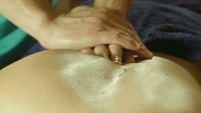Male doing massage on back in spa salon. Massage specialist massaging woman s back at beauty salon stock video