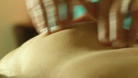 Male doing massage on back in spa salon. Massage specialist massaging woman s back at beauty salon stock video footage