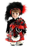Male doll from Scotland. In kilt on a white background Stock Photos
