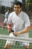 Male doubles tennis players waiting for serve Stock Images