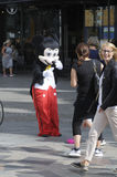 MALE DRESSES AS  MICKY MOUSE FOR SMALL CASH Royalty Free Stock Photo