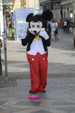 MALE DRESSES AS  MICKY MOUSE FOR SMALL CASH Stock Photography