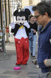 MALE DRESSES AS  MICKY MOUSE FOR SMALL CASH Stock Photo