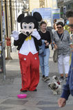 MALE DRESSES AS  MICKY MOUSE FOR SMALL CASH Stock Image