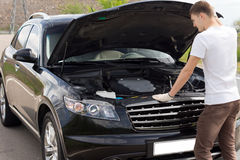 Male driver checking his car engine Royalty Free Stock Photo