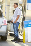 Male Driver Filling Car At Gas Station Royalty Free Stock Photos