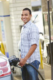 Male Driver Filling Car At Gas Station Stock Photo