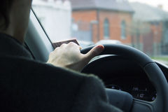 Male driver hands holding steering wheel.Driving safety in the city Royalty Free Stock Image