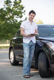 Male Driver Holding a Touch Pad Tablet PC Royalty Free Stock Photo
