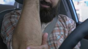 Male driver massaging arm to relieve elbow pain, joint inflammation, health