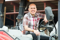 Male driver operating  tractor Stock Image