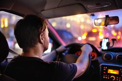 Male driver ride a car during evening traffic jam Stock Images