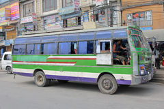 Male driver stops his mini bus at bus stop in Kathmandu, Nepal Royalty Free Stock Image