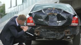 Male driver taking photo of car damage after accident, insurance compensation. Stock footage stock video