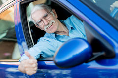 Male driver with thumbs up Stock Photo