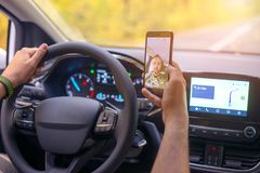 Male driver using smartphone to capture selfie pictures while dr stock images