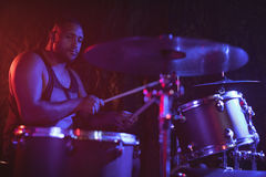 Male drummer performing at music concert. Confident male drummer performing at music concert Royalty Free Stock Images