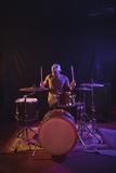 Male drummer performing in nightclub. Confident male drummer performing in nightclub Stock Images
