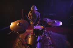 Male drummer performing in nightclub. High angle view of male drummer performing in nightclub Stock Photos