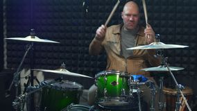 Male drummer playing drums with drumsticks. Male drummer playing the drums with drumsticks in recording music studio. Live music stock video