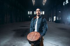 Male drummer playing on wooden drum. Musician in motion. Bongo, musical percussion instrument, ethnic music Stock Photos