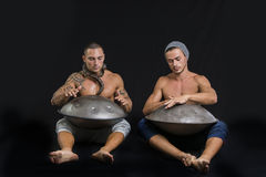 Male Drummers Drumming on Steel Drums in Studio Stock Images